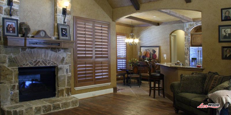 Sunland Shutters for a Contemporary Family Room with a Plantation Shutters and Sunland Stained by Expressions in Window Fashions