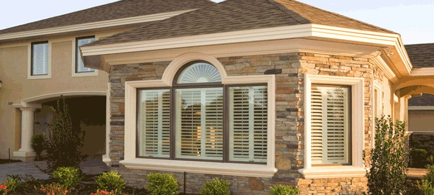 Sunland Shutters for a Transitional Exterior with a Poly Shutters and Polycore Shutters by Sunland Design Llc