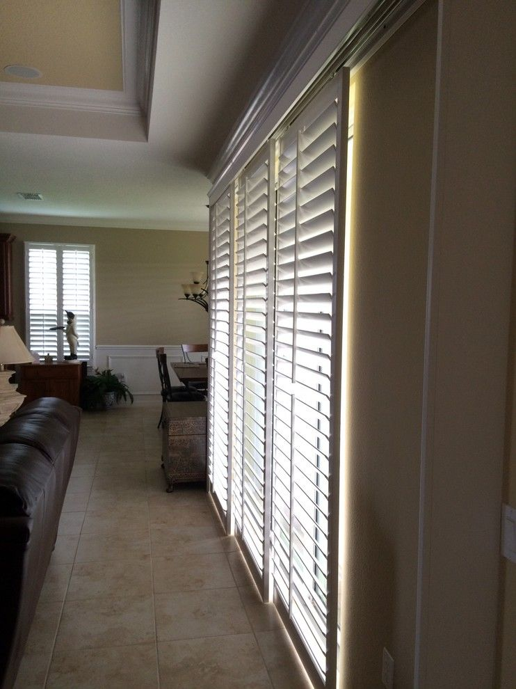 Sunland Shutters for a Transitional Family Room with a 3 12 Louvers and by-Pass Shutters by DBS by Ginger LLC