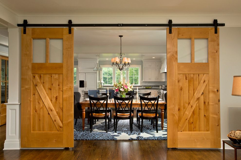 Sunnyvale Rod and Gun for a Farmhouse Dining Room with a Pendant Chandelier and Farmhouse Vernacular by Teakwood Builders, Inc.