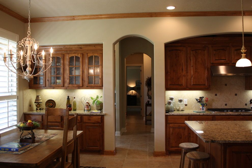 Sunnyvale Rod and Gun for a Traditional Kitchen with a Travertine and Gun and Rod by Mill Creek Custom Homes