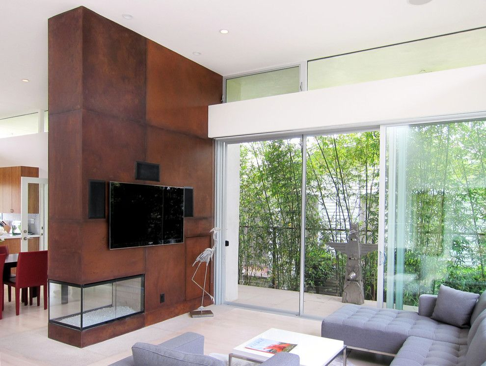 Sweet Ga Juke Joint for a Modern Living Room with a Small Fireplace and Venice Transformation by Tpa Studio