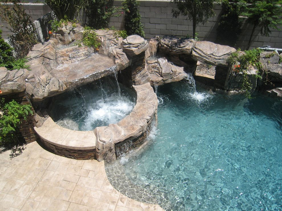 Sylvan Pools for a Rustic Pool with a Cantilevered and Freeform Pool & Spa   Silverado Springs   Las Vegas, Nv by Anthony & Sylvan Pools