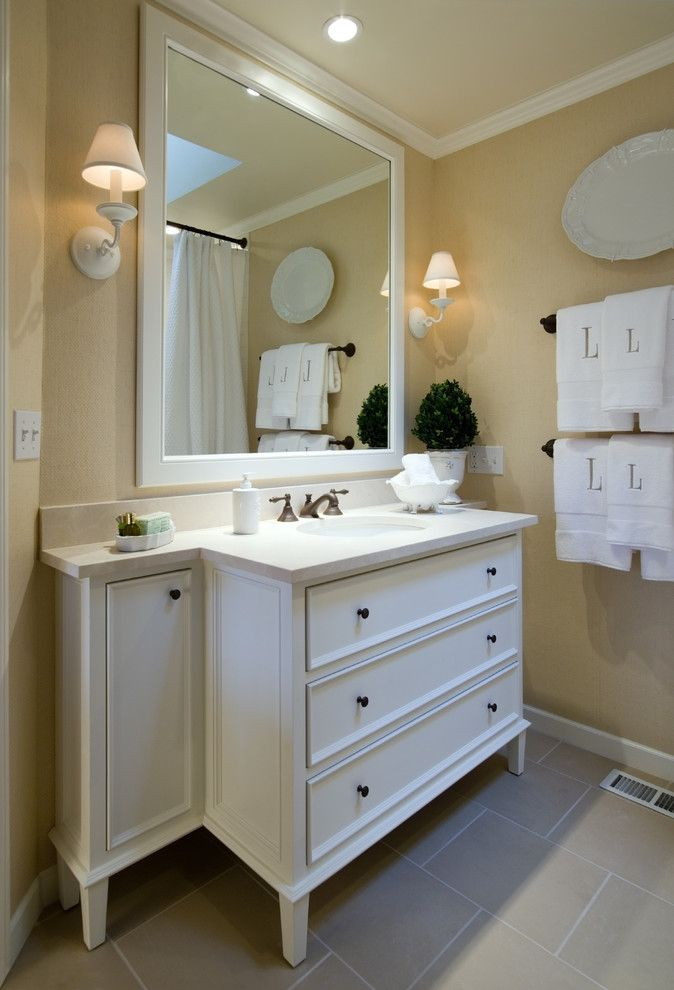 Sysco Guest Supply for a Traditional Bathroom with a Wall Lighting and Murrayhill Hall Bath by Rockwood Cabinetry
