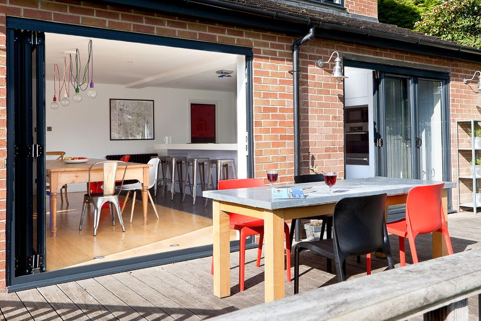 Table Shuffleboard Rules for a Contemporary Patio with a Kitchen and Wickets by Boutique Homes