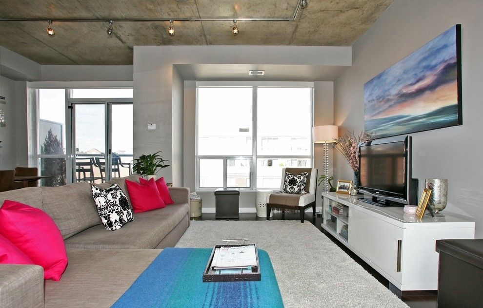 Tailor Lofts for a Contemporary Family Room with a Dark Brown Cabinet and King West Loft by High Street Design