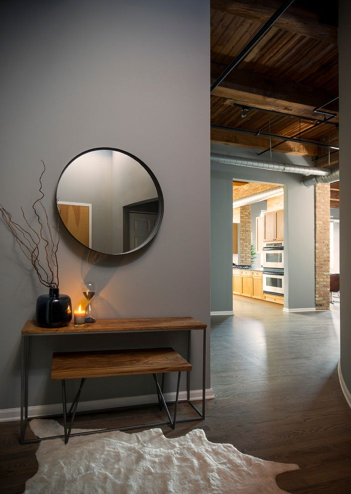 Tailor Lofts for a Industrial Entry with a Restoration Hardware and River North Loft by Haven Design Studio