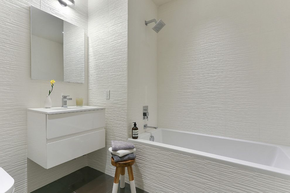 Texturing Walls for a Contemporary Bathroom with a Wall Mirror and E.7th St. Condo, Manhattan Ny by Eisner Design Llc
