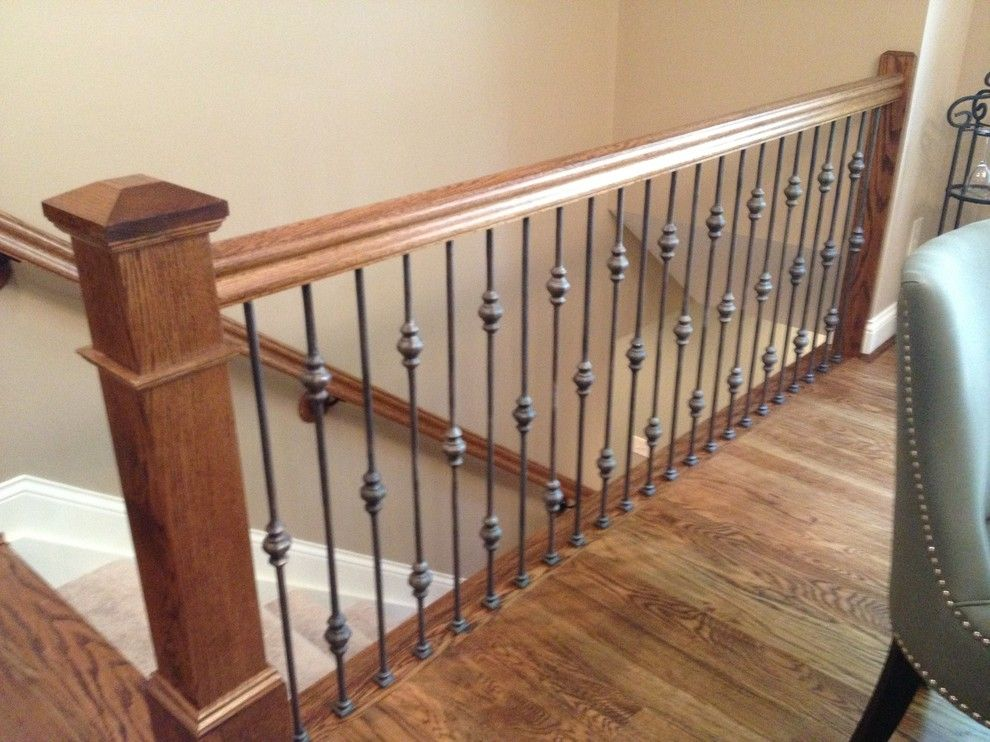 The Ashleys for a Traditional Staircase with a Box Newel with Wrought Iron Railing and Stair Railing Projects by Ashley Construction / Ashley Remodeling