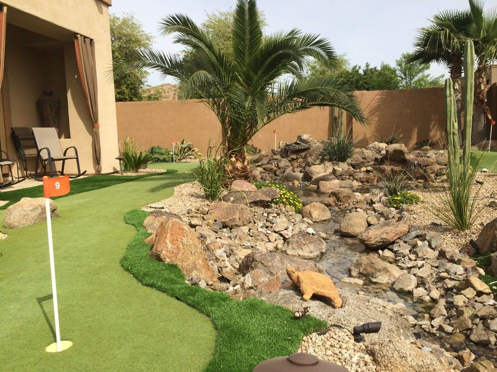 The Boulders Golf for a Contemporary Landscape with a Fire Pot and Residence #1 at Whitewing Chandler by La Modo