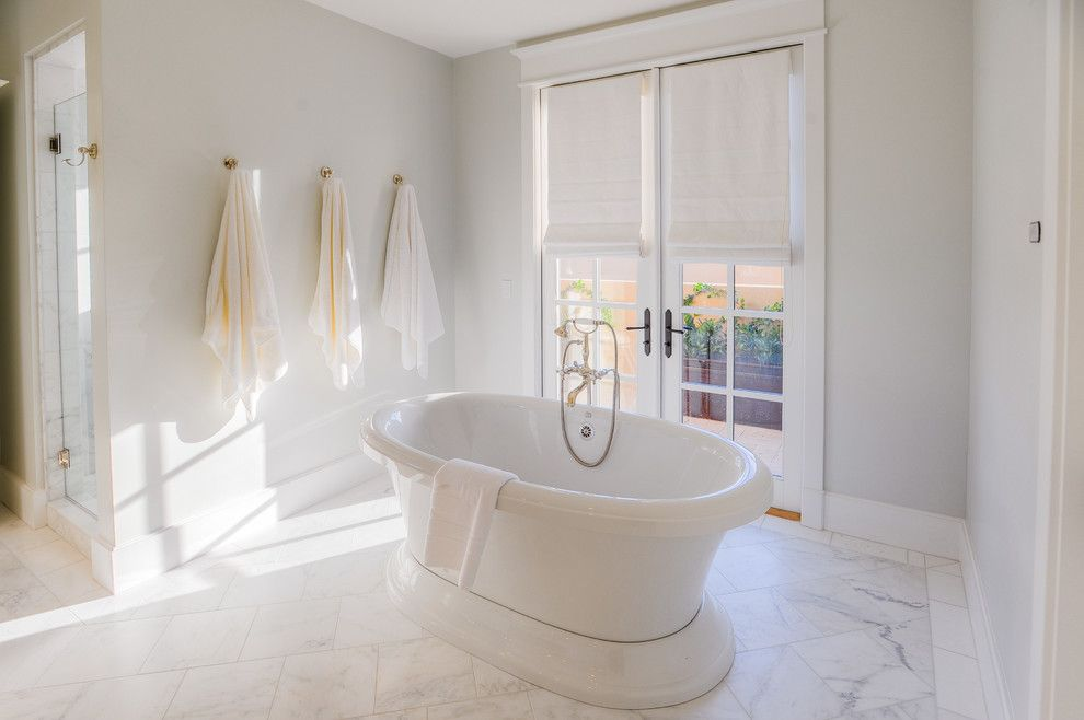 The Courts at Huntington Station for a Transitional Bathroom with a White Painted Wood and Desert Dwelling for Sports Enthusiasts | Master Tub by Drewettworks
