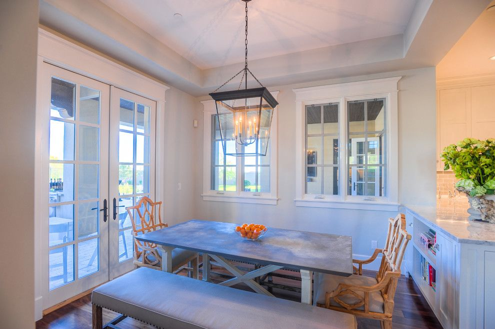 The Courts at Huntington Station for a Transitional Dining Room with a Neutral Palette and Desert Dwelling for Sports Enthusiasts | Informal Dining by Drewettworks