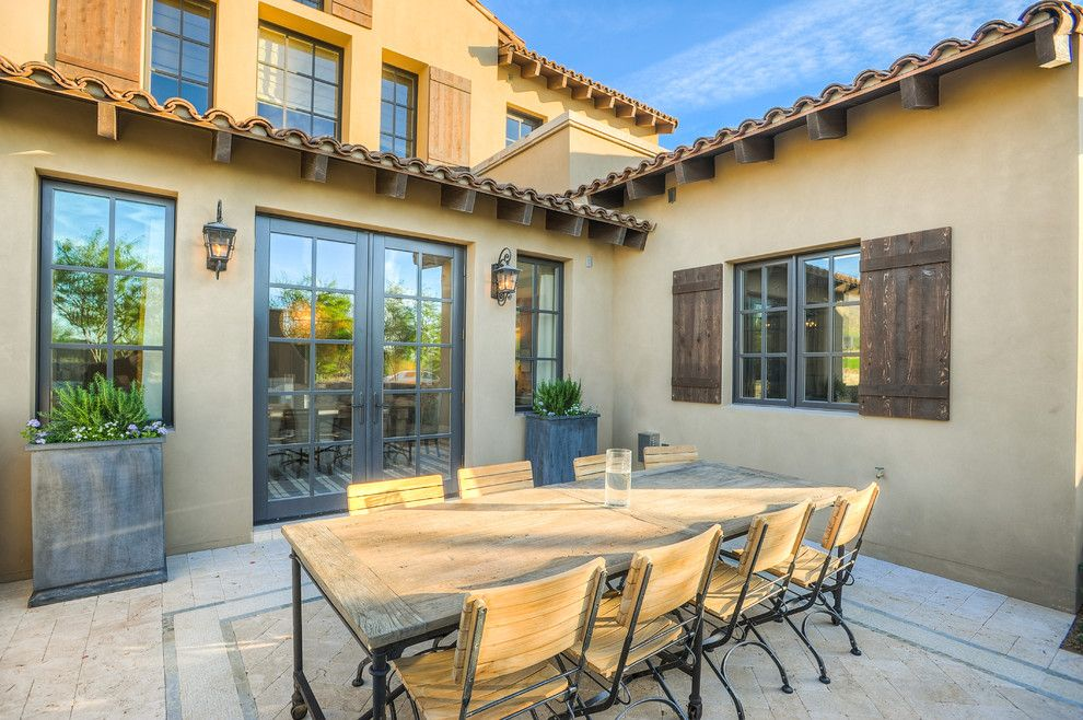 The Courts at Huntington Station for a Transitional Patio with a Wrought Iron Lighting and Desert Dwelling for Sports Enthusiasts | Outdoor Dining by Drewettworks