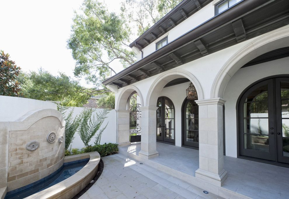 The Iron Giant Cast for a Mediterranean Porch with a Covered Walkway and Sullivan, Henry, Oggero and Associates, Inc. by Sullivan, Henry, Oggero and Associates, Inc.