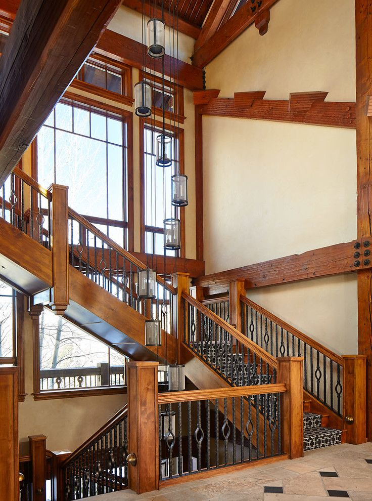 The Iron Giant Cast for a Rustic Staircase with a Wood Paneling and Renovated Mountain Retreat by Greenauer Design Group