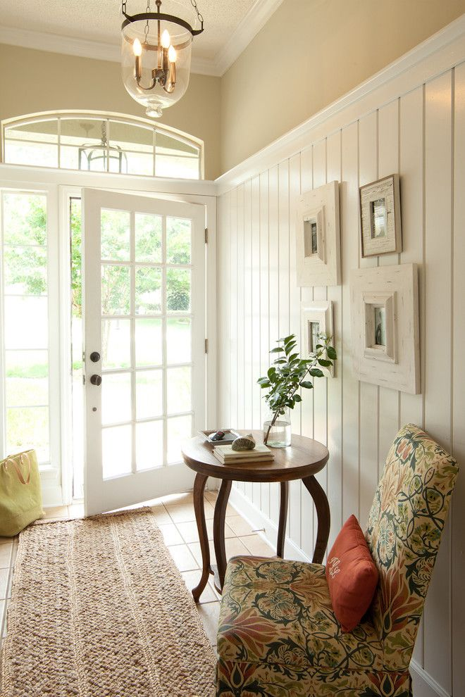 The Sanderling for a Beach Style Entry with a Pendant Light and Entry by Lauren Leonard Interiors