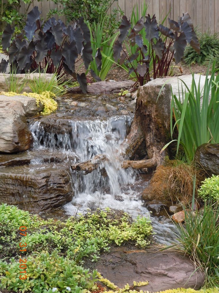 The Seasons Laurel Md for a Rustic Landscape with a Indoor Outdoor Living and Pondless Waterfalls, Disappearing Waterfalls, Baltimore, Maryland (Md) by Arbor Ridge Services