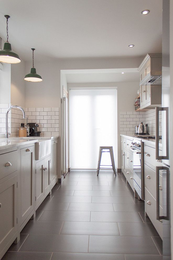 Tile and Stone Warehouse for a Contemporary Kitchen with a Floor Tile and the Hither Green Shaker Kitchen by Devol by Devol Kitchens
