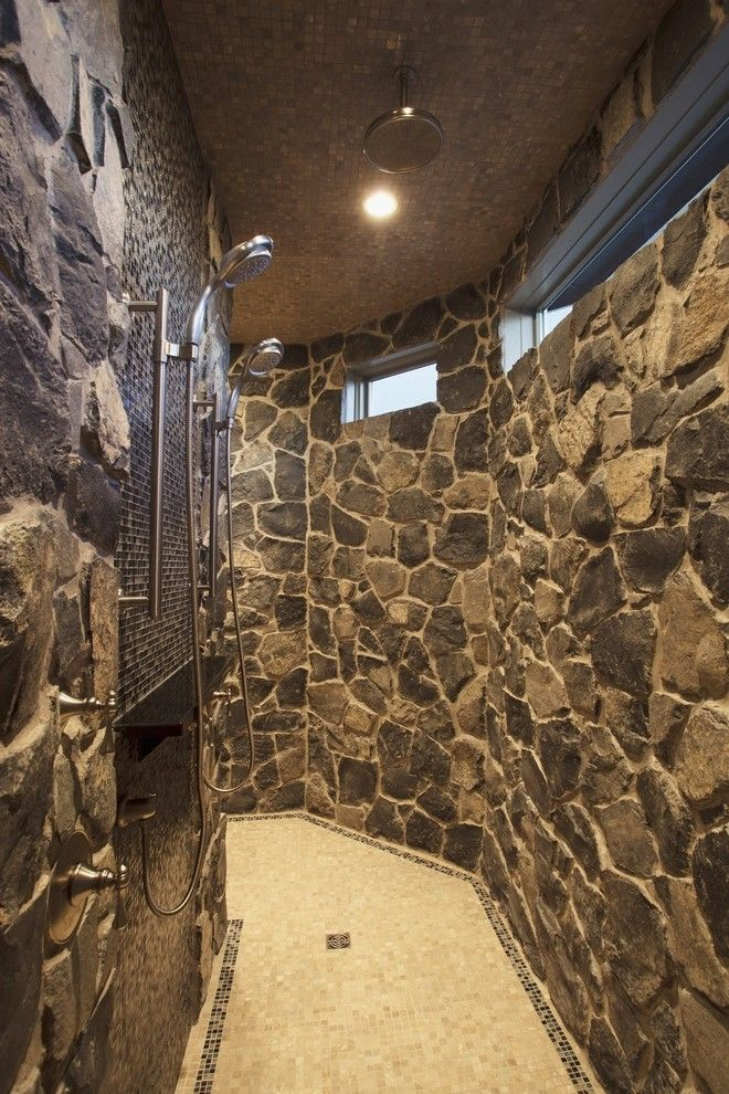 Tile and Stone Warehouse for a Traditional Bathroom with a Rain Shower and Bungalow Show Home in Springbank by Wolf Custom Homes Ltd.