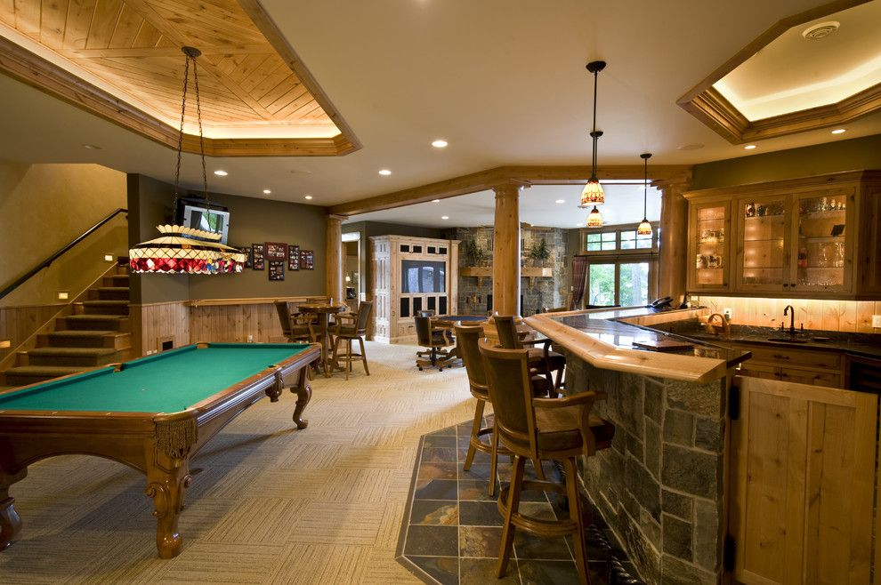 Tile and Stone Warehouse for a Traditional Family Room with a Basement Bar and Recreation Room by Nor Son, Inc.