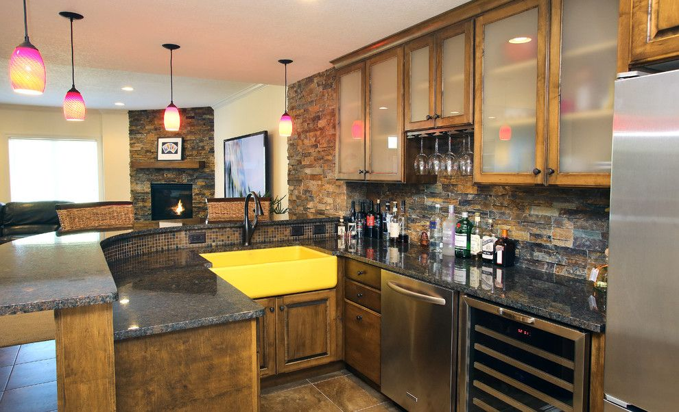 Tile and Stone Warehouse for a Transitional Home Bar with a Glass Front Cabinets and Basement Remodel Bar by Homefront Interior Design