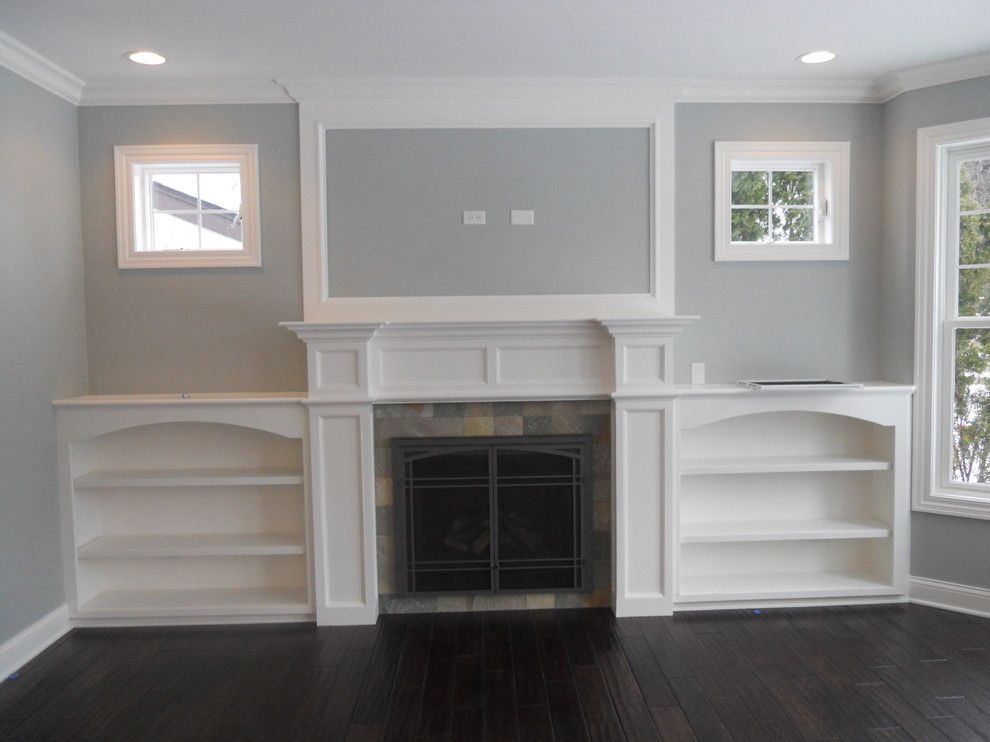 Tile Outlet Chicago for a Transitional Family Room with a Built in Bookshelves and Fireplace by Coora Construction Inc