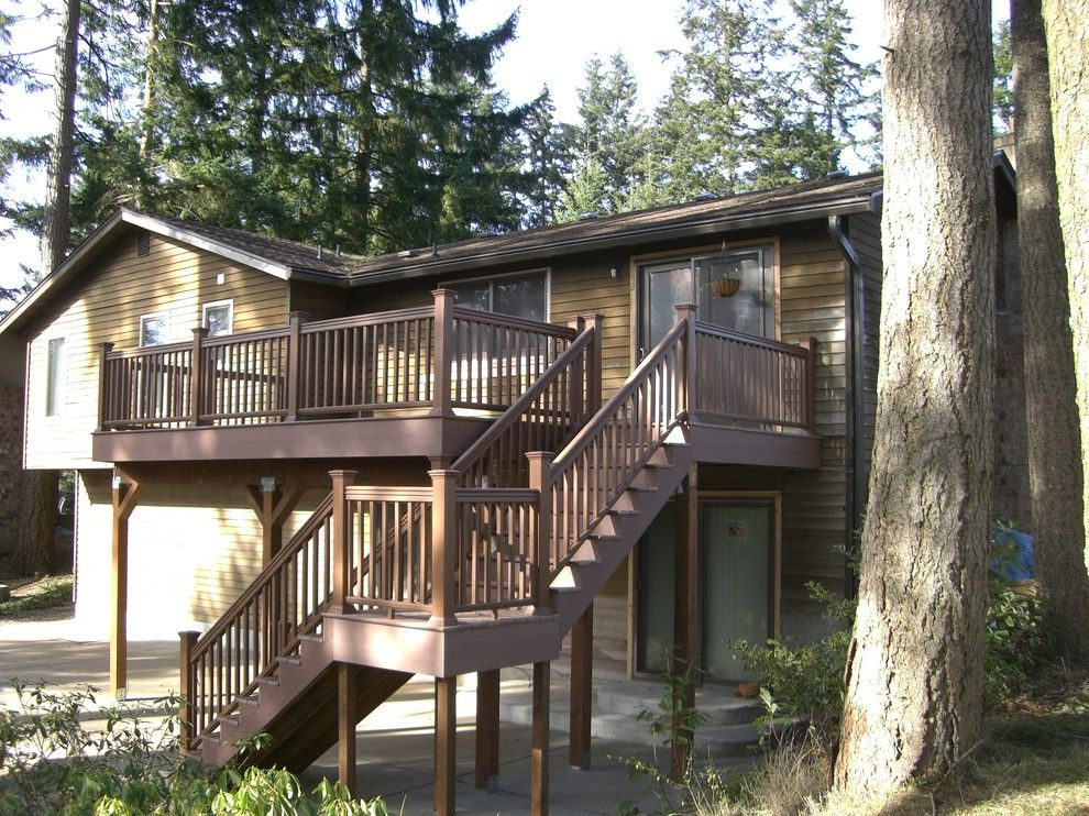 Timber Tech for a Farmhouse Deck with a Wooden Deck Rails and Deck and Rail Projects by Decks and Patio Covers