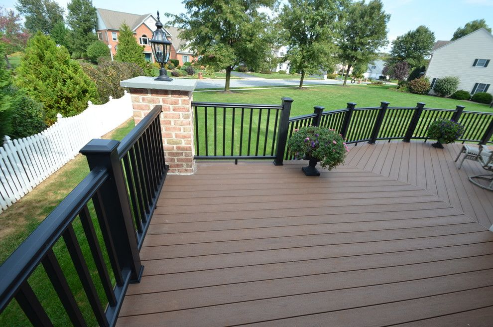 Timber Tech for a Traditional Deck with a Custom Brick Columns and Custom Timbertech Deck by Breyer Construction & Landscape