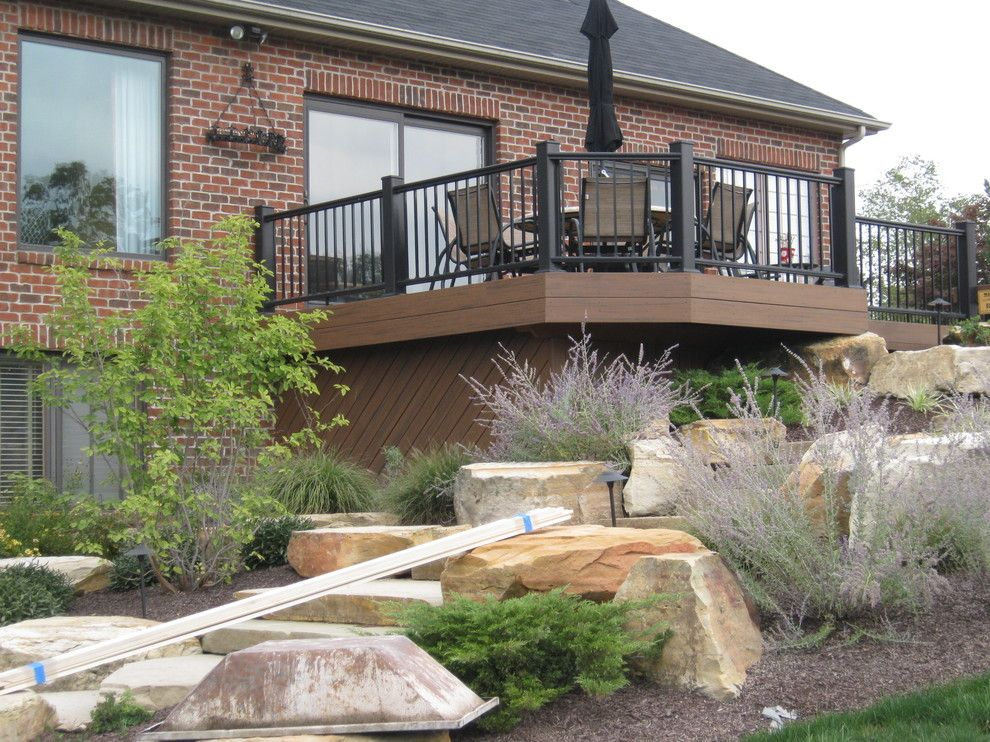 Timber Tech for a Traditional Exterior with a Azek Railing and Fort Wayne Timbertech Deck with Azek Railing by Archadeck Northeastern Indiana