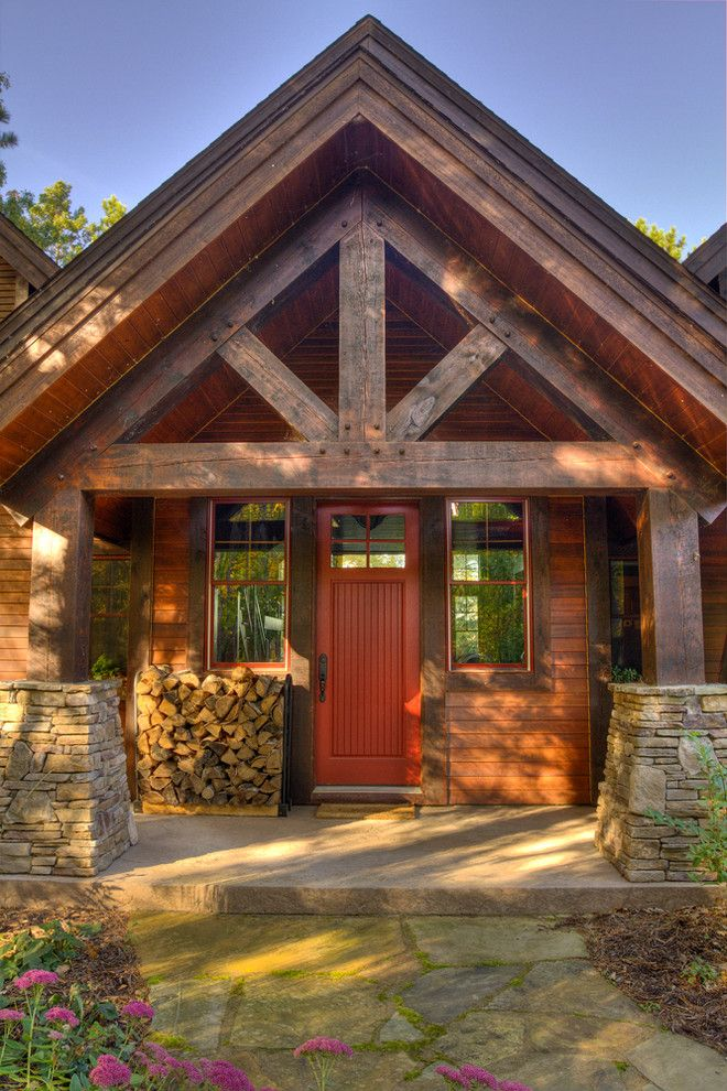 Timber Wolf Size for a Rustic Porch with a Stone and Thunder Lake Entry by Lands End Development   Designers & Builders