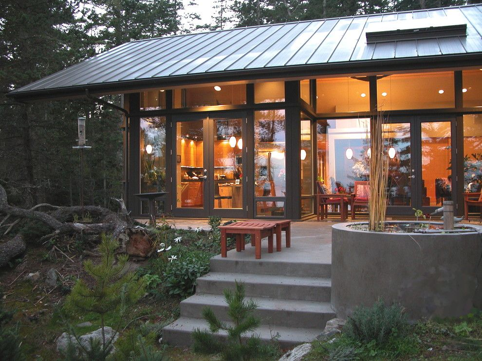 Tin Roof Rusted for a Rustic Exterior with a Terrace and Orcas12 by Jeff Luth   Soldano Luth Architects