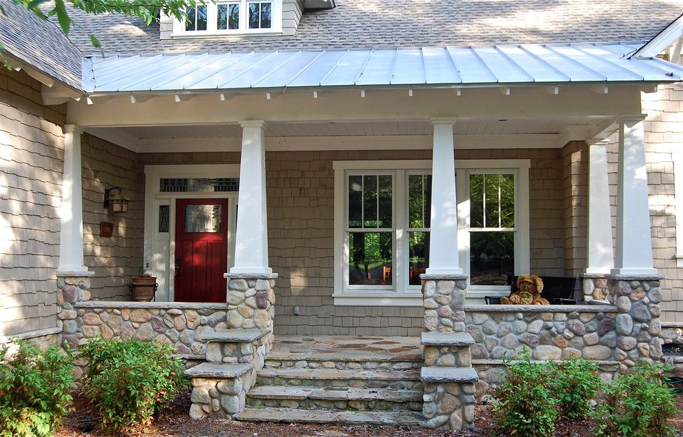 Tin Roof Rusted for a Traditional Porch with a White Door Trim and Lake Oconee Craftsman by Dreambuilt, Inc.