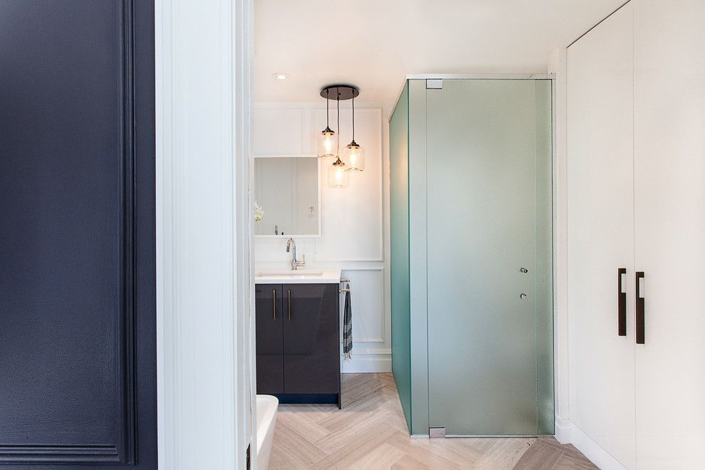 Tint Masters for a Contemporary Bathroom with a Herringbone Pattern and Clarendon Avenue by Veronica Martin Design Studio