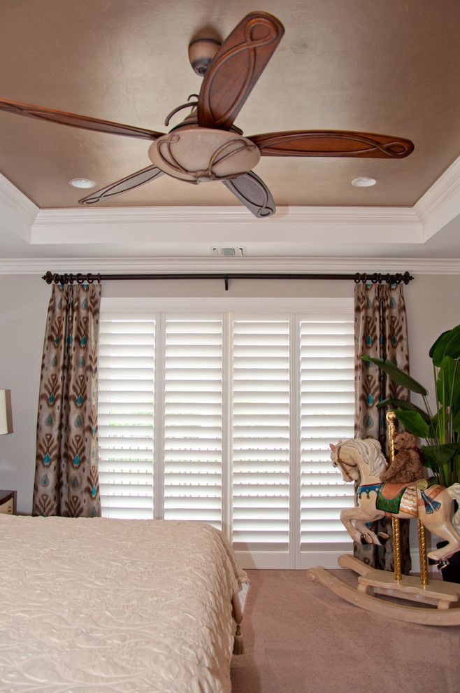 Tint Masters for a Transitional Bedroom with a Peacock and Custom Window Treatments in Miromar Lakes Home by Beverly Hills Window Tinting and Treatments