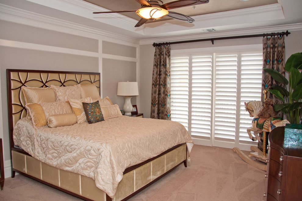 Tint Masters for a Transitional Bedroom with a Raised Ceiling and Custom Window Treatments in Miromar Lakes Home by Beverly Hills Window Tinting and Treatments