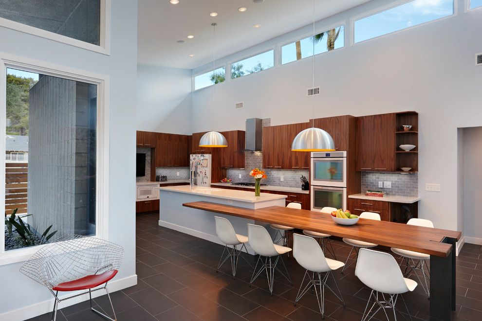 Tmart Furniture for a Midcentury Kitchen with a High Ceiling and Andserson Residence by Bunnyfish Studio