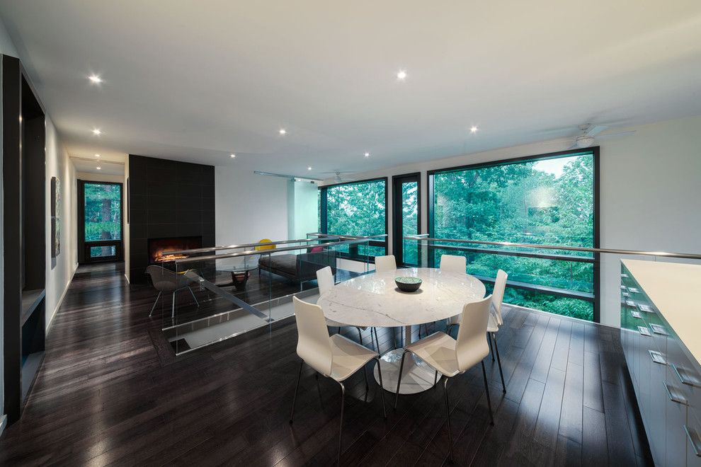 Tnt Window Tinting for a Modern Dining Room with a Dark Wood Floor and Chelsea Hill House by Kariouk Associates