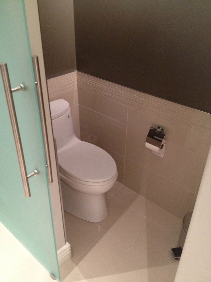 Toliet for a Contemporary Spaces with a Sliding Glass Door and Bathroom Renovations by Tay Ky Developments