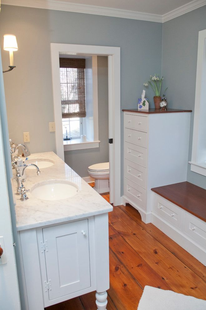 Toliet for a Farmhouse Bathroom with a Inset Cabinetry and Carter Republic House by Jarrett Design, Llc
