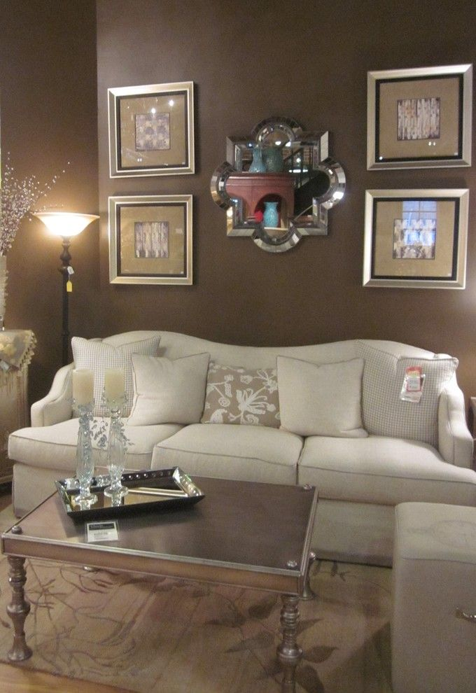Torchere for a Eclectic Living Room with a Mirror and Photos by Classic Interiors