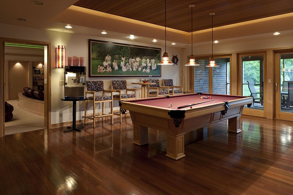 Tractor Pull Games for a Eclectic Family Room with a Pool Table and Private Residence by Don F. Wong