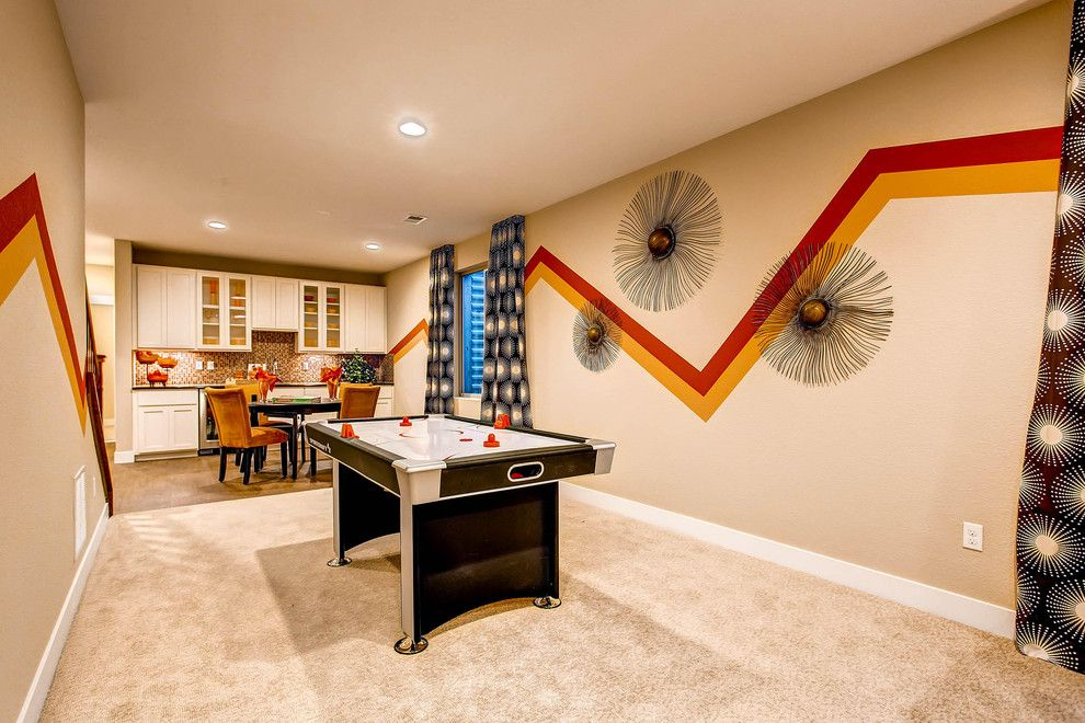 Tractor Pull Games for a Traditional Basement with a Beige Carpet and Expressions at Stapleton by Wonderland Homes