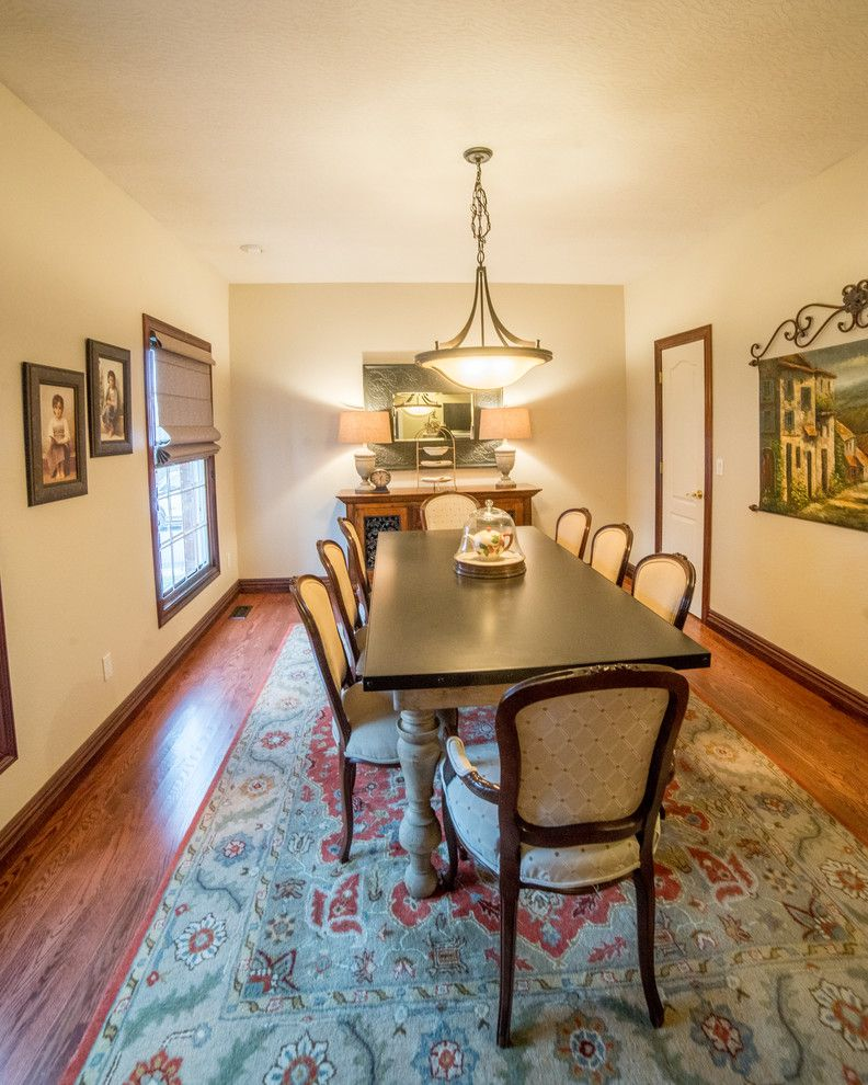 Traditional Housewarming Gifts for a Transitional Dining Room with a Orb Chandelier and Traditional Dining Room by Ellecor Design & Gifts by Haden Long