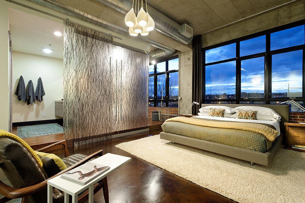 Translucent Concrete for a Contemporary Bedroom with a Black Window Trim and Denver Loft Remodel by Weber Interior Design