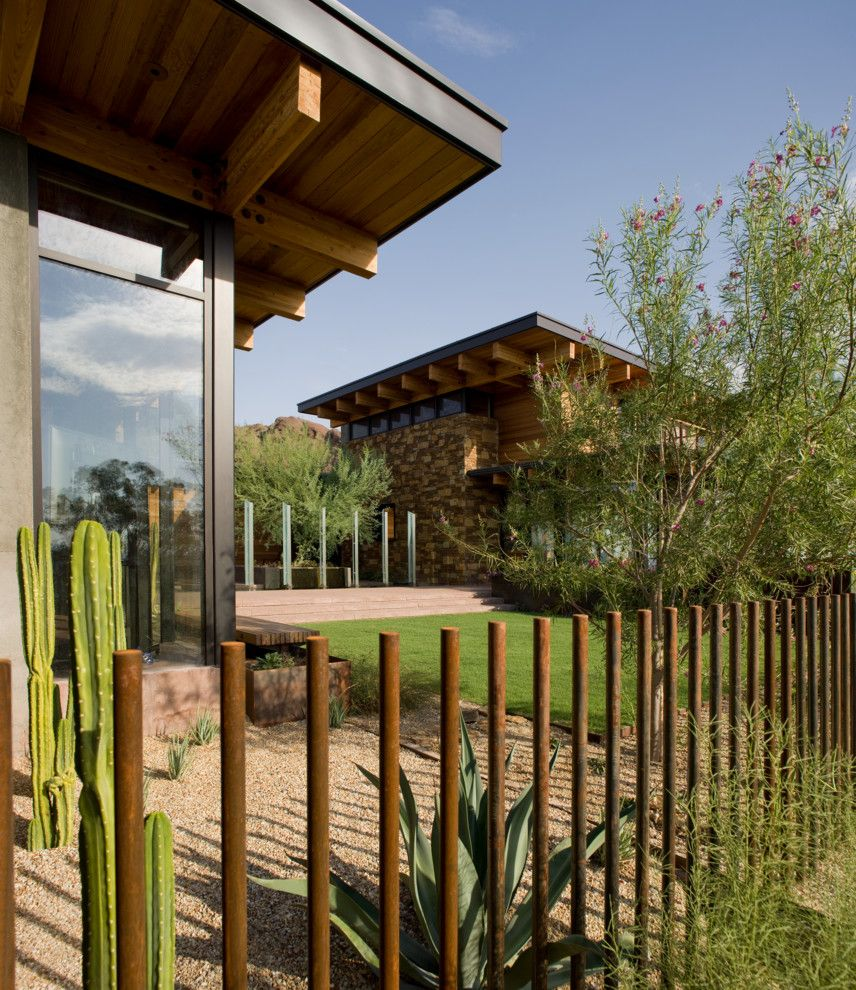 Translucent Concrete for a Contemporary Landscape with a Flat Roof and Camelback by Stonecreek Building Company, Inc.