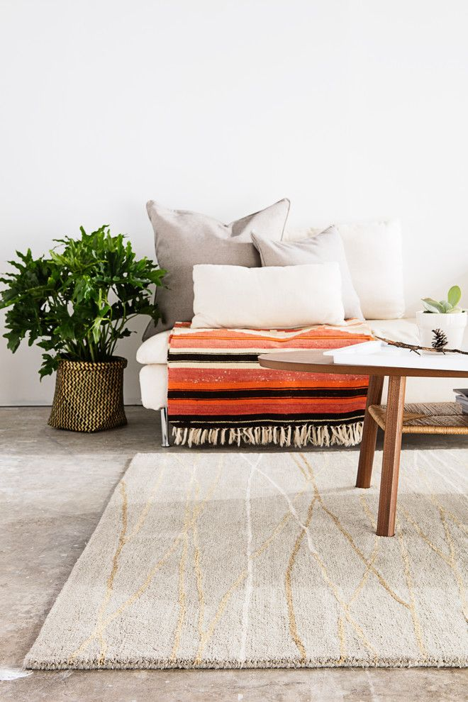 Translucent Concrete for a Scandinavian Living Room with a Striped Throw and Jaipur Living by Jaipur Living
