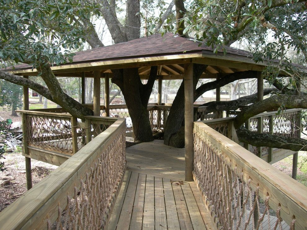 Treehouse Builders for a Traditional Patio with a Custom Tree House and Tree Houses and Play Sets by Backyard Builders