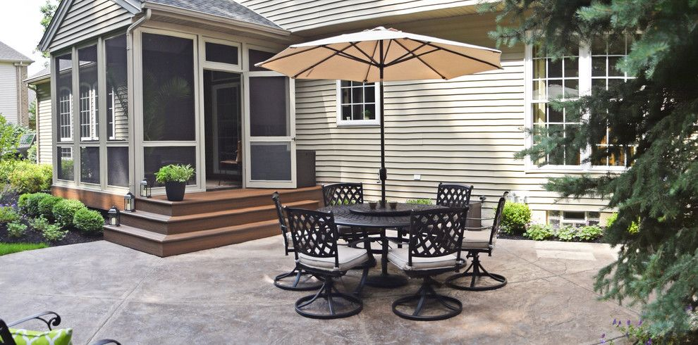 Trex Select for a Modern Patio with a Fire and Stamped Concrete Patio in Avon Lake, Oh by Brian Kyles Landscapes of Distinction