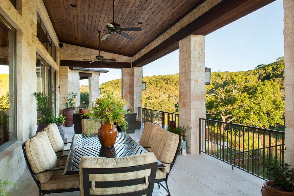 Trex Select for a Rustic Deck with a Metal Railing and Hill Country Custom Home by Dawn Hearn Interior Design
