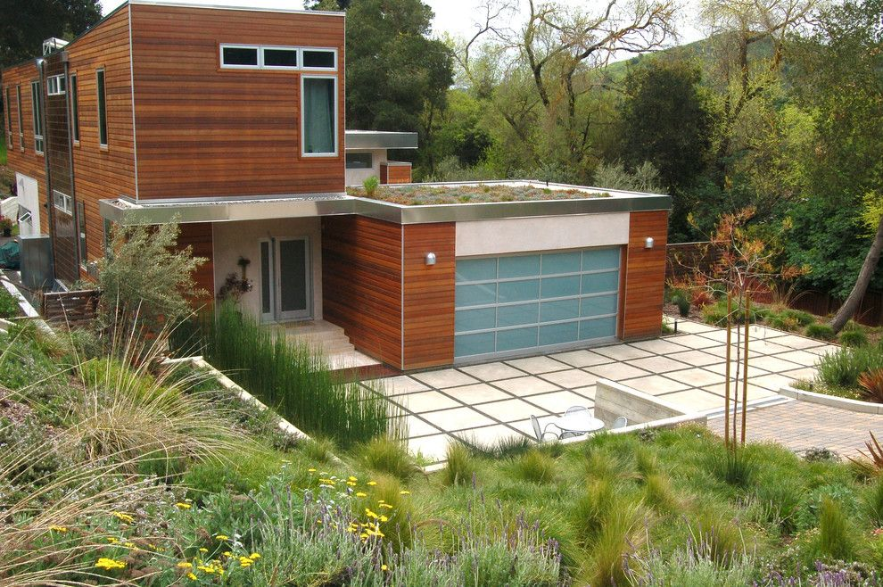 Tri Green Tractor for a Contemporary Landscape with a Patio and Remick by Huettl Landscape Architecture